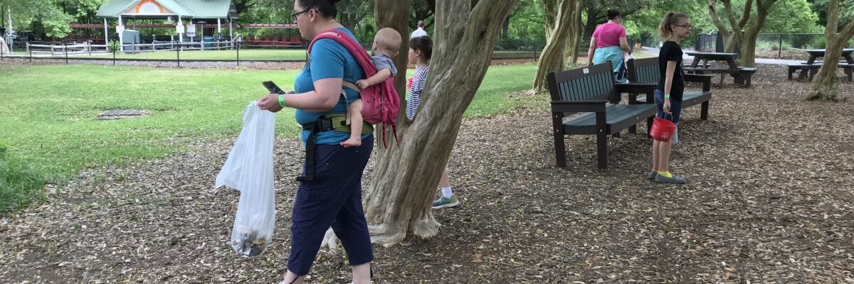 people of all ages picking up litter around Zoo